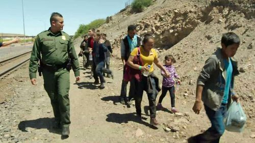 US Border Patrol agent Carlos Antunez arresting immigrants crossing the border into the US illegally.