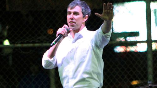 Former Democratic Rep. Beto O'Rourke speaks to a crowd inside an El Paso ball park across the street from where President Donald Trump was holding a rally.