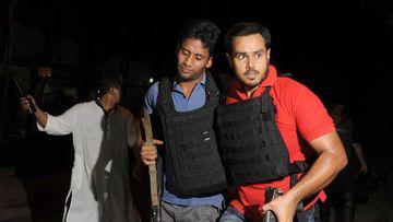 An injured police officer. (AFP)