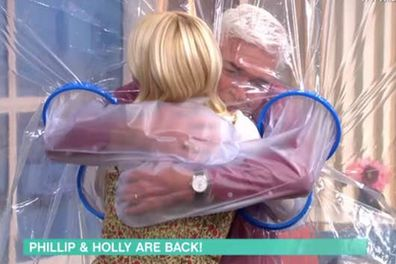 Holly Willoughby, Phillip Schofield, This Morning, hugging, curtain cuddle
