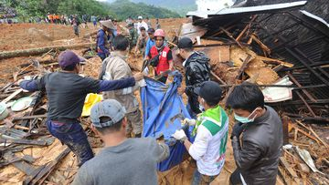 Hundreds of police, soldiers and residents dug through the debris with their bare hands, shovels and hoes as heavy rain hindered their efforts.
