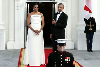 <p>The First Lady opted for a strapless ivory crepe gown custom-made by Lady Gaga's fashion director Brandon Maxwell for the White House State Dinner in honor of Singapore's prime minister</p> <p>Image: Getty.</p>
