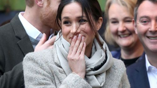 Meghan Markle appeared a little overwhelmed as the crowds cheered for the couple. (Getty)