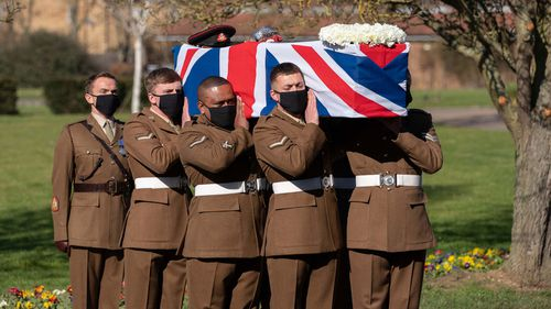 (No reuse after 11.59pm on March 6th 2021 without written consent from gemma@captaintom.org.) The coffin of Captain Sir Tom Moore is carried by members of the Armed Forces during his funeral at Bedford Crematorium on February 27, 2021 in Bedford, England