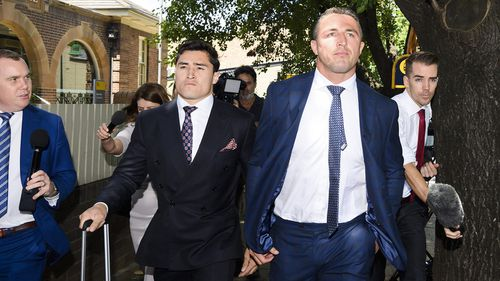 Sam Burgess with his lawyer Bryan Wrench outside Moss Vale Local Court today. The retired Rabbitohs superstar has been found guilty of intimidating his former father-in-law.
