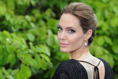 Angelina plays the villain in <i>Maleficent</i>, but she looks purely angelic here!