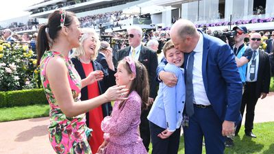 Scenes of elation as trainer Danny O'Brien kisses his teary son after Vow and Declare claims victory at the Melbourne Cup.