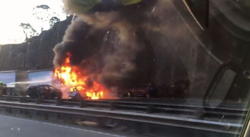 The ute was crushed under the truck, bursting into flames.