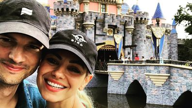 Ashton Kutcher and Mila Kunis at Disneyland