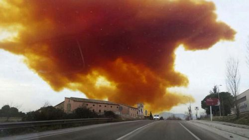 The toxic orange cloud above the town of Igualada. (AAP)