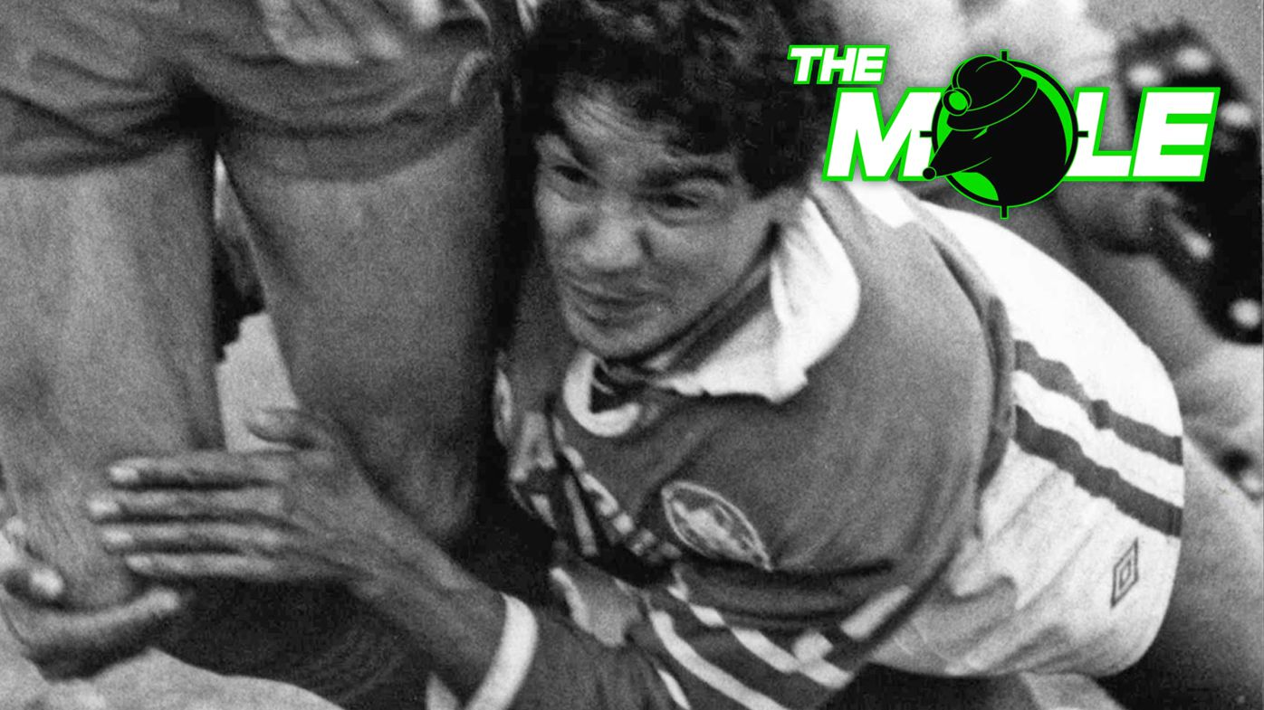 Newtown's Ray Blacklock gets Parramatta's Mick Cronin in a copybook tackle around the legs