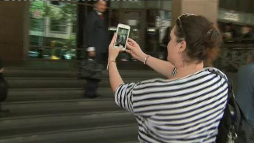 Malkah took a quick selfie with the media outside court. (9NEWS)