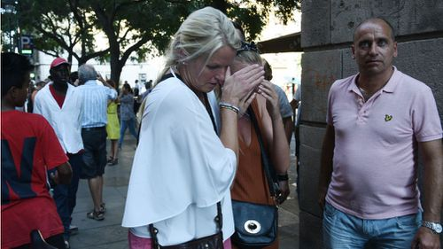 Distressed witnesses near Las Ramblas. (AP)