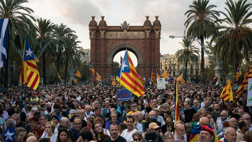 Pro-independence supporters holding Catalan flags take part in rally near the Parliament, in Barcelona, Spain. (AP)