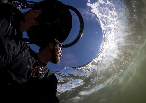 Two pilots in an Aquatica submarine disappear under the water's surface. The expedition's mission is to further ocean education, conservation and scientific research.