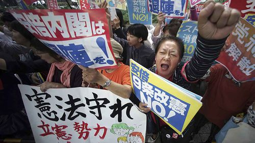 Protesters gather outside the Diet in Tokyo. (AAP)