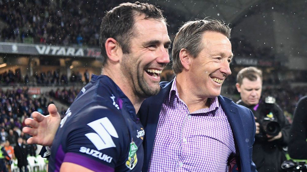 Cameron Smith and Craig Bellamy celebrate winning the NRL minor premiership. (Getty Images)