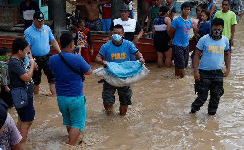 More than 120 people have died after being swept away by flash floods in the Philippines. (AAP)