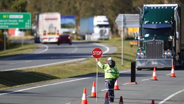 Queensland Police stop vehicles on the border with NSW.