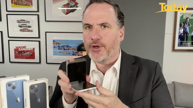 'Hello, it's a phone that flips in half,' Long said, gleefully snapping the phone down.