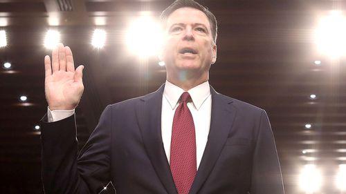 Sacked FBI director James Comey swears an oath. (AAP)