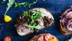 Open steak sandwich with aioli, rocket and caramelised onion