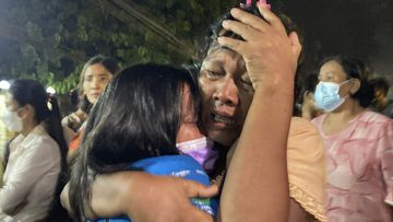 A mother reacts after her daughter, left, was released from Insein Prison in Yangon, Myanmar.