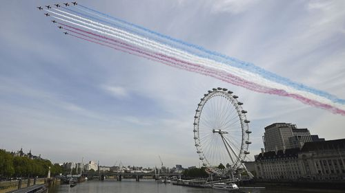 The Red Arrows, officially known as the Royal Air Force Aerobatic Team flies over the London Eye in London on Friday, May 8, 2020 on the 75th anniversary of the end of World War II in Europe.