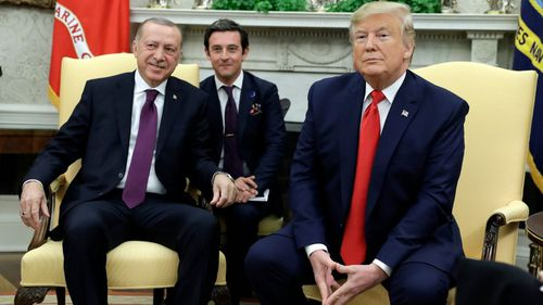 "Trump was meeting Turkey's president during the hearings and said he was ""too busy"" to watch."