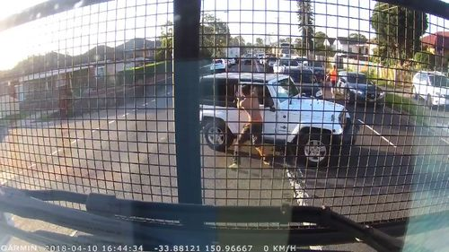 The man is alleged to have repeatedly punched the Jeep driver through the window. (Dash Cam Owners Australia)