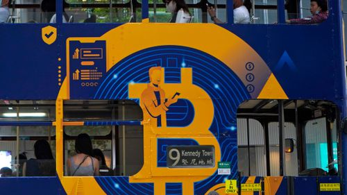 An advertisement of Bitcoin, one of the cryptocurrencies, is displayed on a tram in Hong Kong.