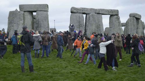 Crowds gather around Stonehenge during last year's Winter Solstice. (PA Wire)