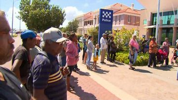 About 100 people gathered outside the Geraldton Police Station.