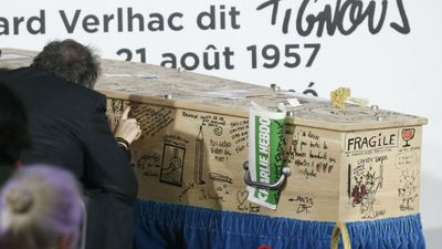 The coffin of the Charlie Hebdo cartoonist was festooned with cartoons and messages of love and support from friends, family and fans of Tignous' work. (AFP)