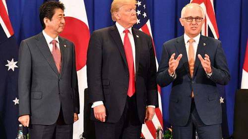 Japan's President Shinzo Abe, U.S. President Donald Trump and Australia's Prime Minister Malcolm Turnbull at a trilateral meeting during the Association of South East Asian Nations (ASEAN) forum in Manila, Philippines. (AAP)