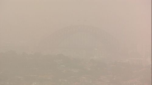 The Sydney Harbour Bridge is barely visible as thick clouds of dust roll eastward.