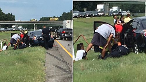 Police officer cradles boy injured in car accident