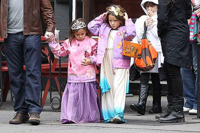 Looking pretty in pink, Isabella and Gia Damon are led around the West Village of New York City on a trick-or-treat tour by their dad, Matt Damon, and mum Luciana Barroso.
