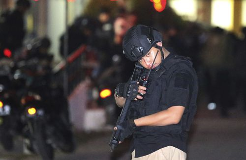 The bombings killed 13 people, including two police officers, and wounded 40. (AAP)