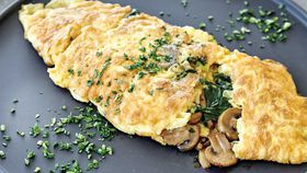 Pan fried mushroom omelette with spinach and thyme