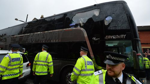 The bus carrying the Manchester United team was escorted by police after having a window smashed on its way to West Ham's Boleyn ground before the English Premier League football match between West Ham United and Manchester United in east London on May 10, 2016. (AFP)