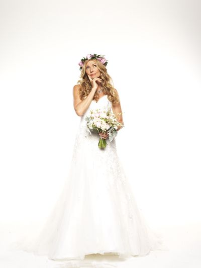 "Deborah Brosnan paired her corsage with loose, flowing curls and a sweet floral head-piece. Her <a href=""http://hillsinhollywood.com/product-category/bridal-gowns/sophia-tolli/"" target=""_blank"">Sophia Tolli</a> dress was fitted with a romantic dropped hemline. Her wedding is coming and we can't wait to see how it goes."