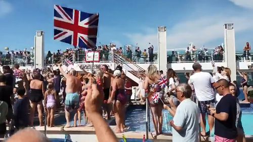 "Richard Gaisford's Twitter account, purportedly showing passengers around a pool on the Britannia. Gaisford wrote: ""Britannia left Bergen at 1430 on Thursday, the violence occurred 12 hours later after a black-tie evening. It followed an afternoon of 'patriotic' partying on deck, with large amounts of alcohol being consumed by many guests."""