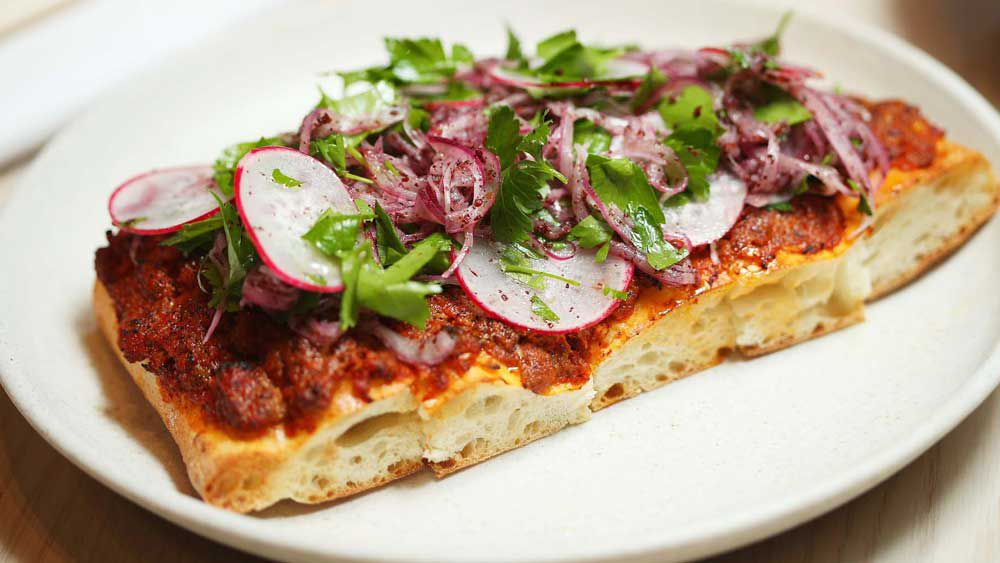 Thi Le's lamb flatbread with parsley and sumac salad recipe
