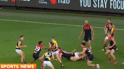 Tigers' late surge sinks Demons in AFL