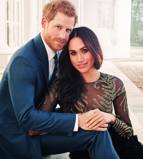 Meghan wore a Ralph & Russo black couture chiffon and tulle gown for her official engagement photographs. (PA/AAP)