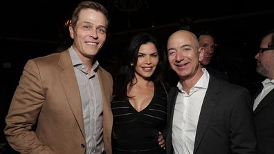 Patrick Whitesell, Lauren Sanchez and Amazon CEO Jeff Bezos attend movie premiere.