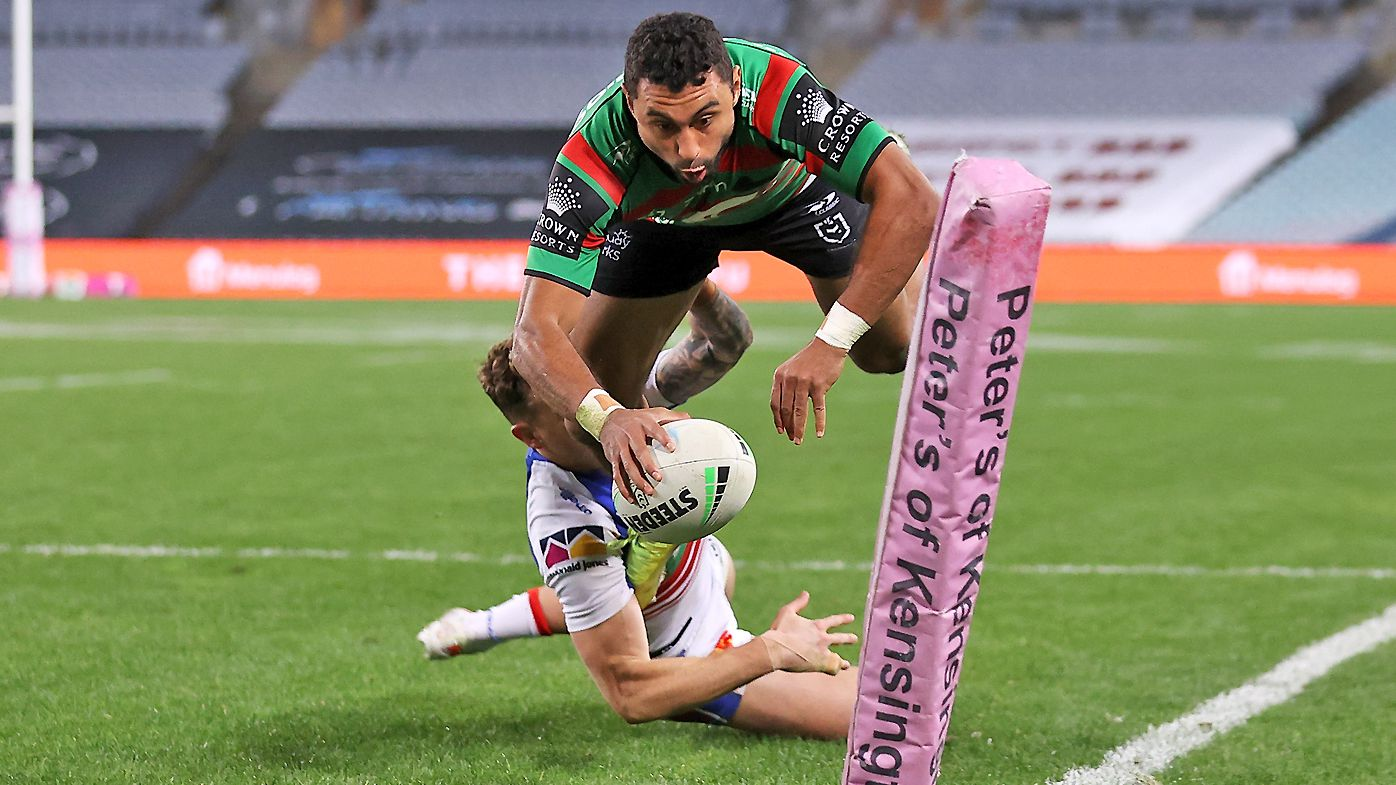 Alex Johnston of the Rabbitohs scores a try