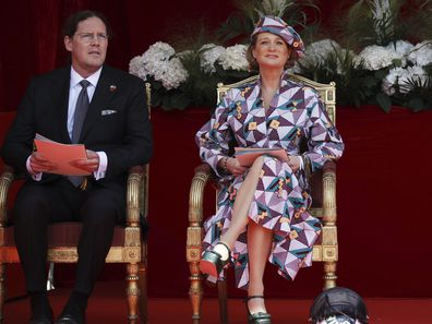 Belgium's Princess Delphine and her husband James O'Hare watch the National Day Parade from the podium in front of the Royal Palace in Brussels, Wednesday, July 21, 2021. Belgium celebrates its National Day on Wednesday in a scaled down version due to coronavirus, COVID-19 measures. (AP Photo/Olivier Matthys)