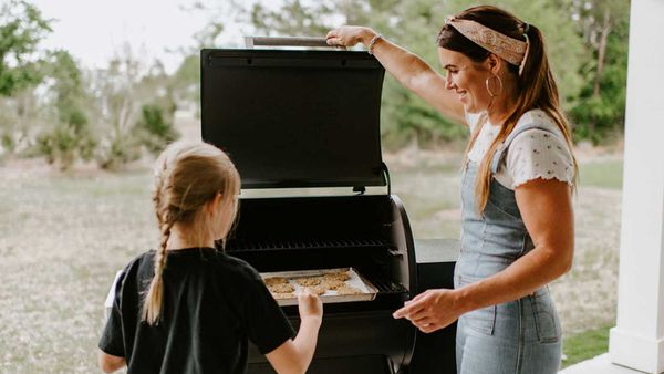 Chef Sarah Glover cooks Anzac biscuits in a wood-fire grill